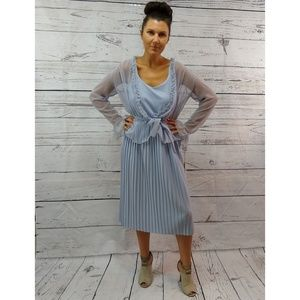 Periwinkle blue pleated dress with ruffle shirt
